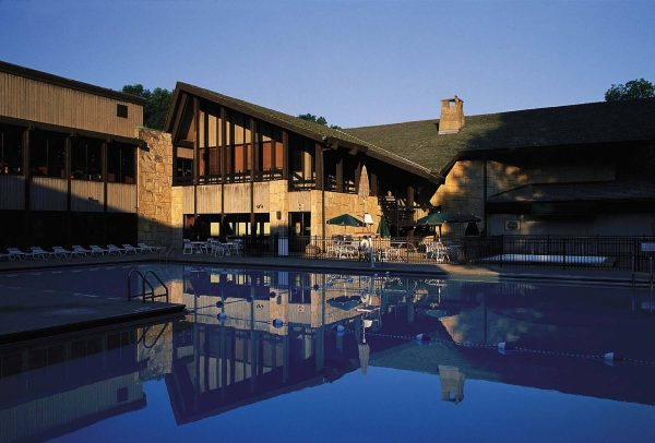 Mohican Lodge at sunset with a view of the outdoor pool