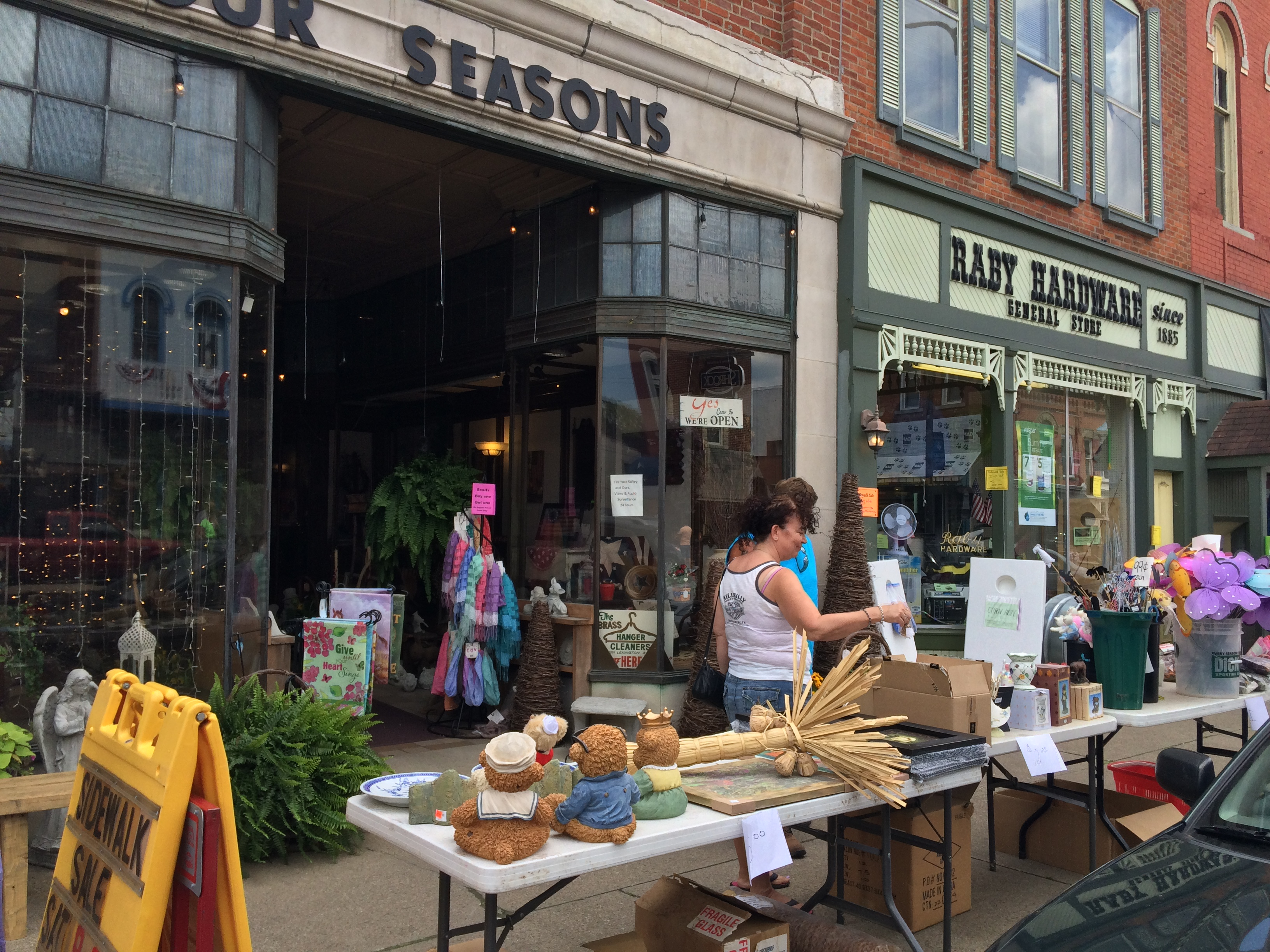 Merchandise tables in front of businesses in downtown Loudonville
