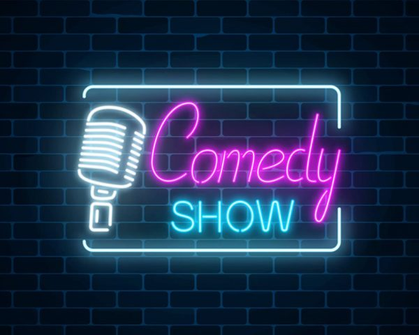 """Neon sign that reads """"Comedy Show"""""""