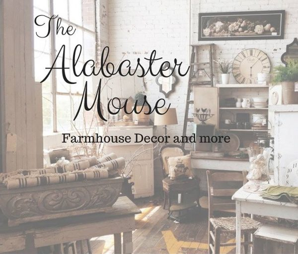 Farmhouse furniture and crafts displayed in the store.