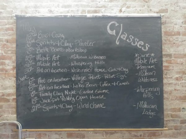 Chalkboard with list of art classes listed.