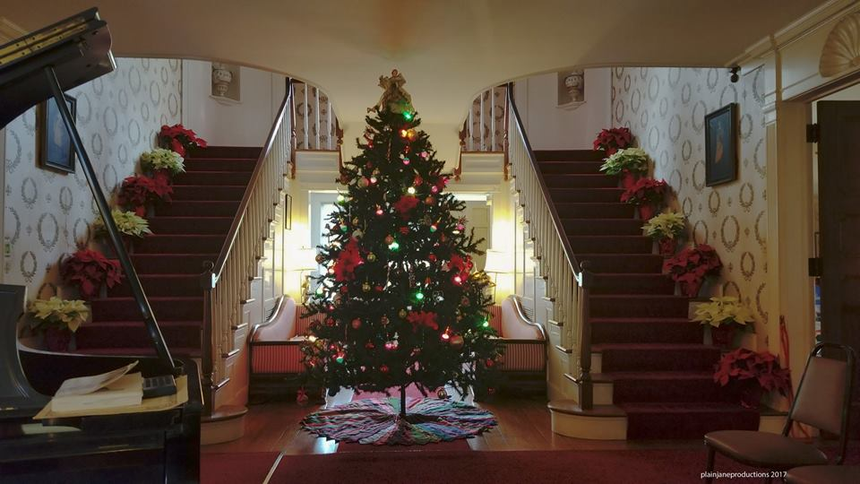 Christmas tree in between staircases at Malabar Farm Big House.