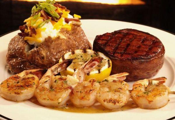 Beef filet, grilled shrimp skewer and loaded baked potato.