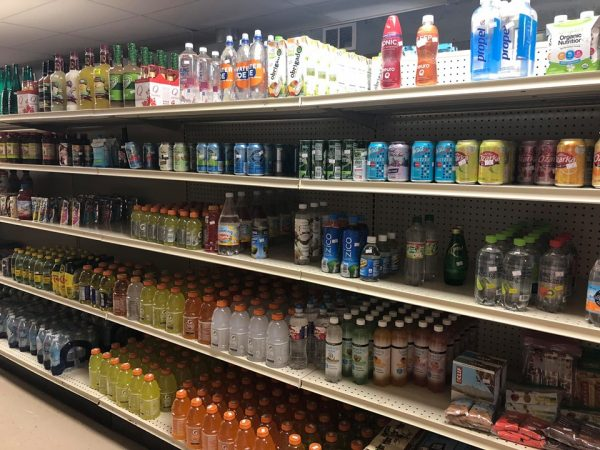 Grocery store shelves filled with beverages in bottles.