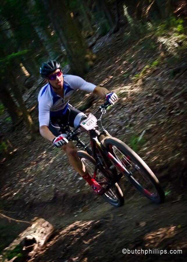 Mountain bike racer on hillside.
